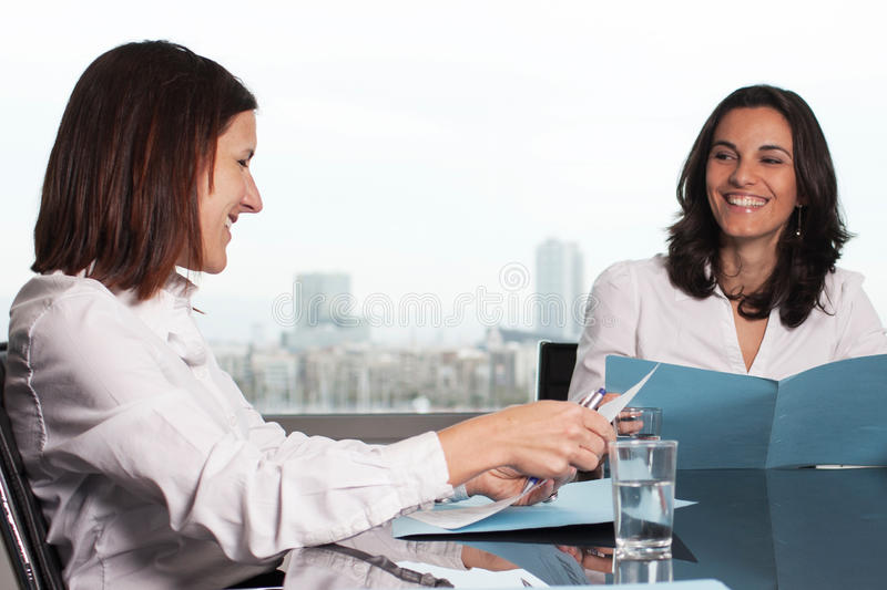 Hispanic businesswoman smiling royalty free stock photography