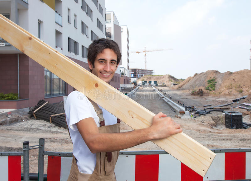 Hispanic carpenter at work on construction site stock photo