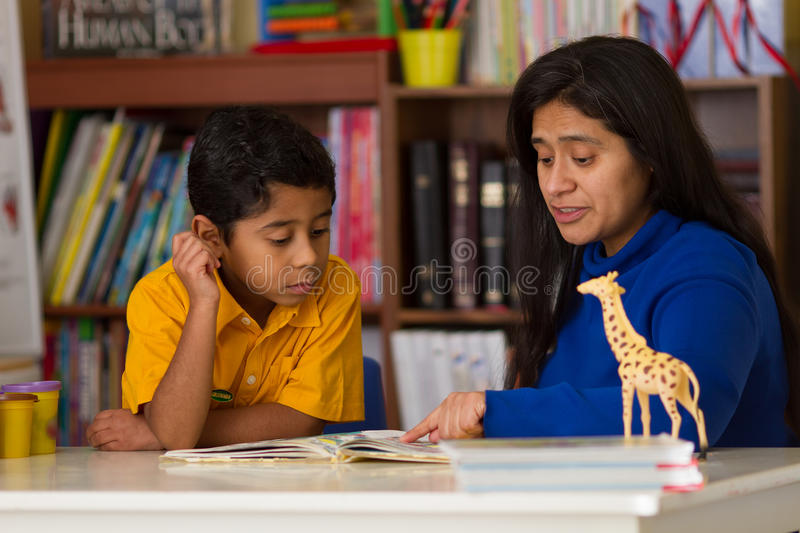 Hispanic Child Learning to Read with Mom stock images