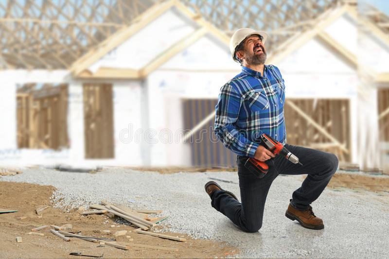 Hispanic Construction worker Getting Back Injury royalty free stock photos