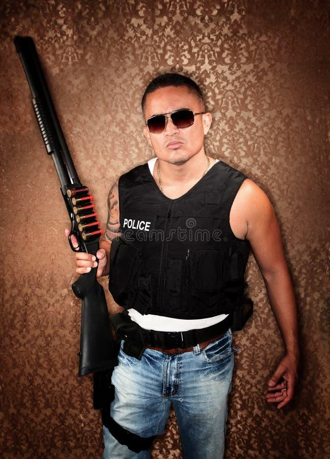Download Hispanic Cop Holding Gun stock image. Image of strap - 12977093