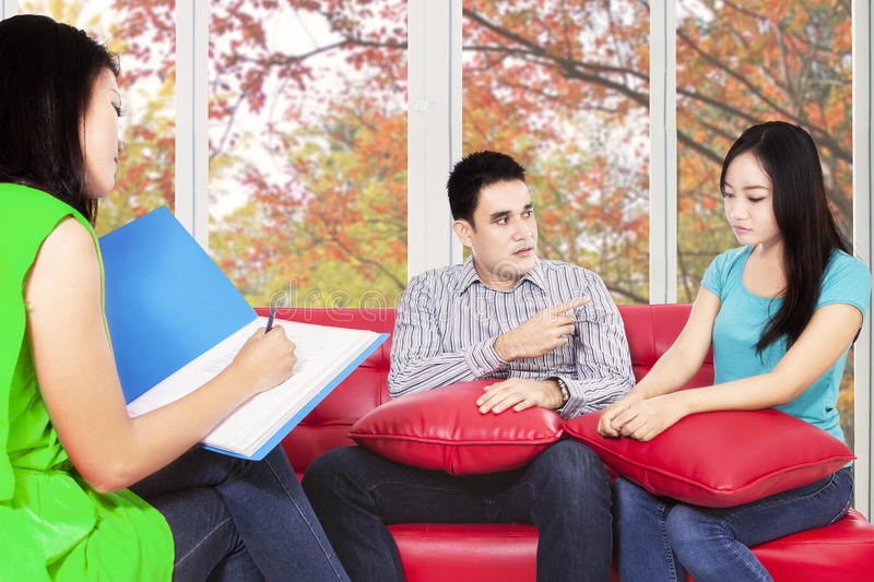 Hispanic couple consulting to psychiatrist. Two asian couple visiting female consultant to consult their problem stock photos