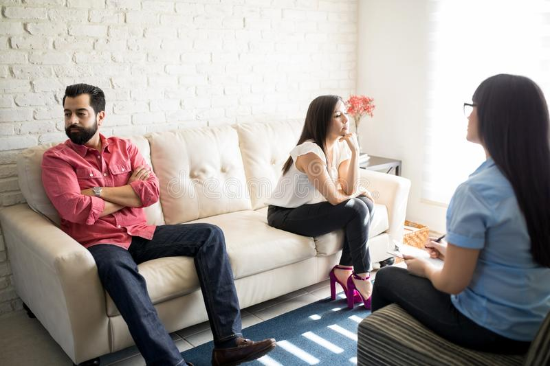 Couple not talking to each other in psychologist office stock images