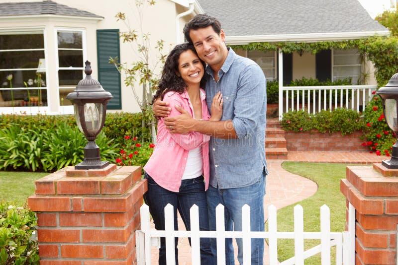 Hispanic couple standing outside home royalty free stock photo