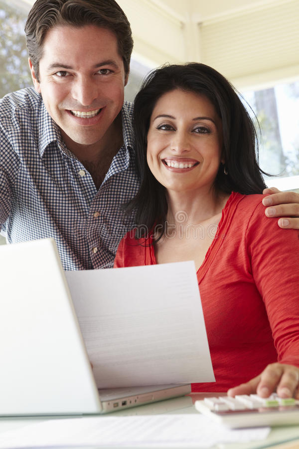 Hispanic Couple Working In Home Office stock image