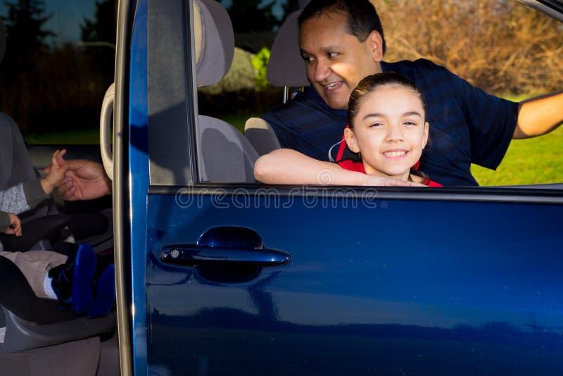 Hispanic Dad Picks Up Daughter After Cheerleader Practice stock photography