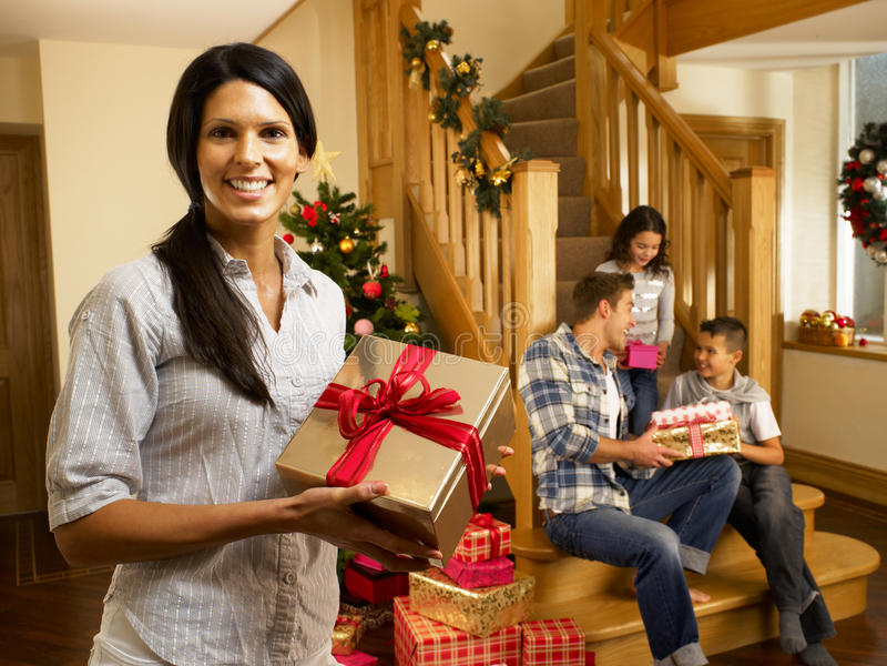 Hispanic family at christmas exchanging gifts