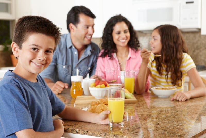 Hispanic family eating breakfast stock image