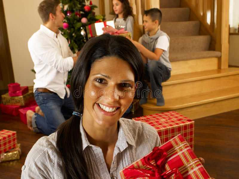Download Hispanic Family Exchanging Gifts At Christmas Stock Photo - Image: 20464818