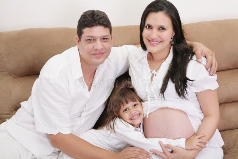 Hispanic family expecting new baby stock photos