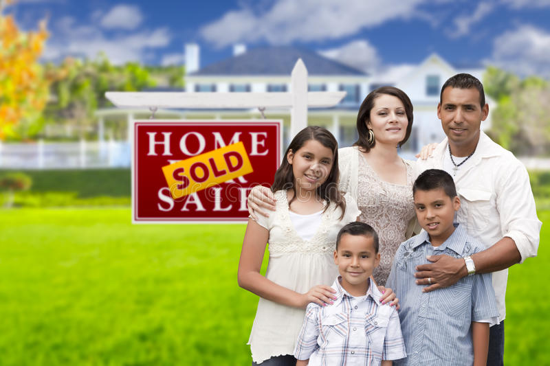 Hispanic Family in Front of Sold Real Estate Sign, House stock photos