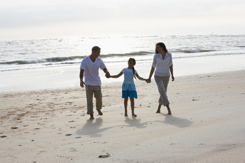 Download Hispanic Family Holding Hands Walking On Beach Stock Image - Image: 14769921