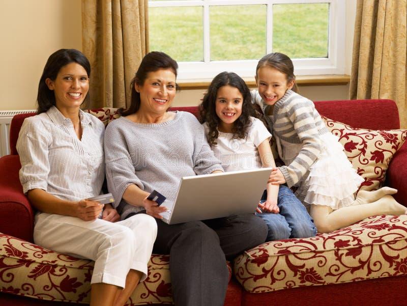 Hispanic family at home shopping online. Smiling at camera royalty free stock images