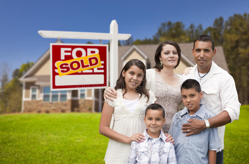 Hispanic Family, New Home and Sold Real Estate Sign stock images