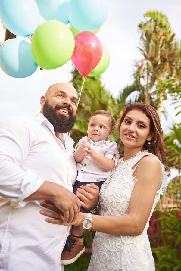 Hispanic family in park stock image
