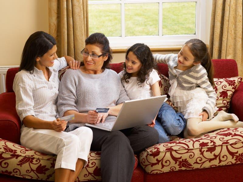 Hispanic family shopping online. At home royalty free stock image