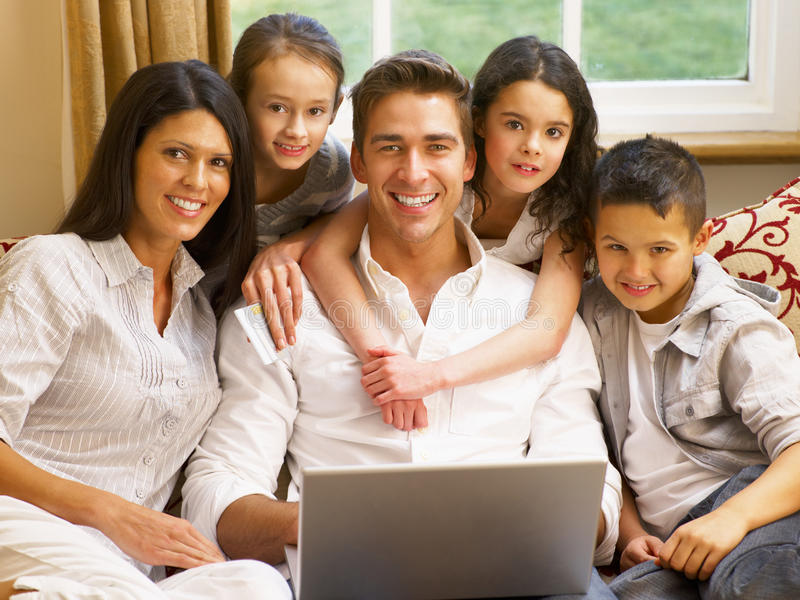 Hispanic family shopping online. Smiling at camera royalty free stock images