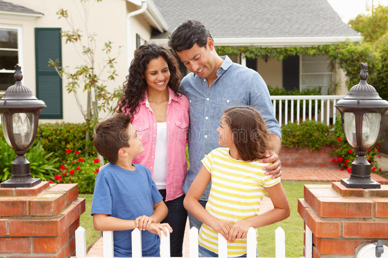 Download Hispanic Family Standing Outside Home Stock Photo - Image: 21156472