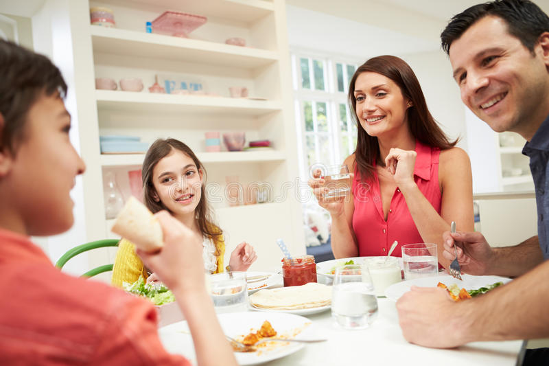 Hispanic Family At Table Eating Meal Together royalty free stock photos