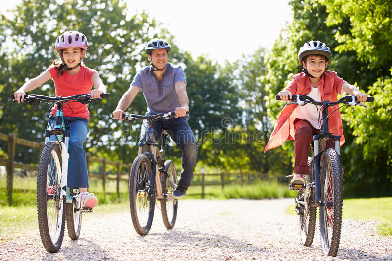Hispanic Father And Children On Cycle Ride royalty free stock photos