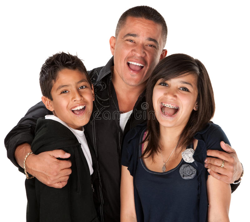 Hispanic Father Hugging Kids. Native American father holding his children and laughing on white background royalty free stock photos