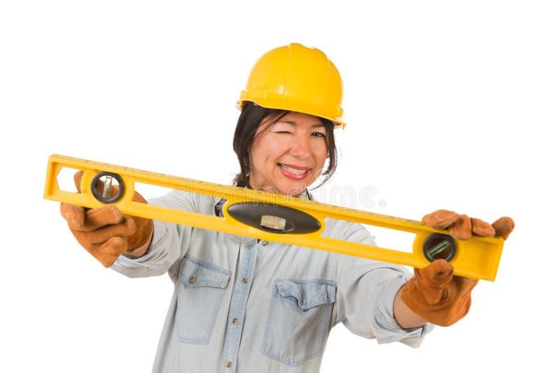 Hispanic Female Contractor Holding Level Wearing Hard Hat Isolated on White Background stock images