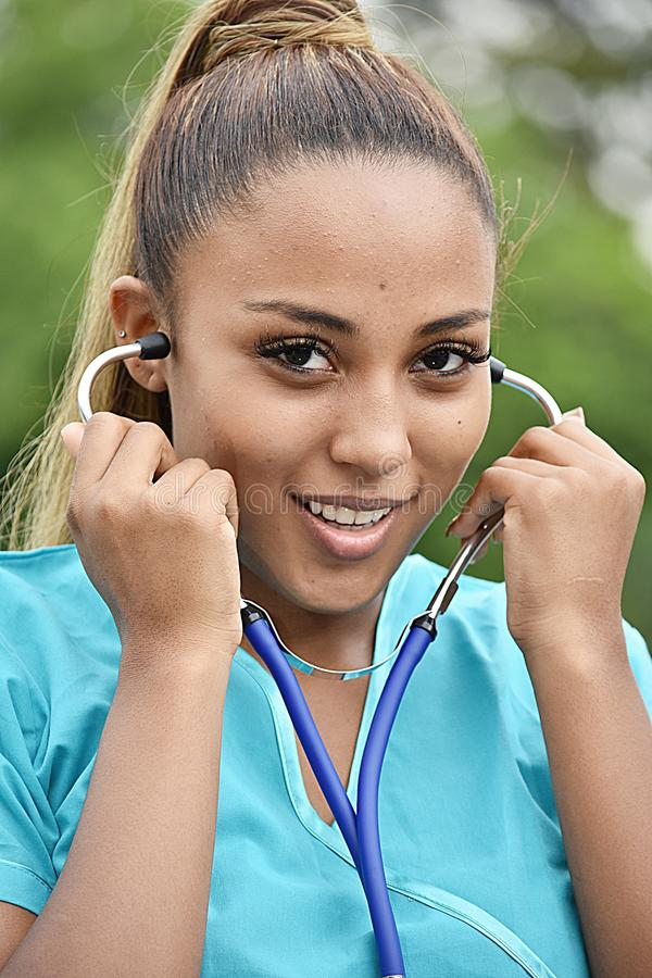 Hispanic Female Nurse Posing. A pretty young Colombian teen girl stock images