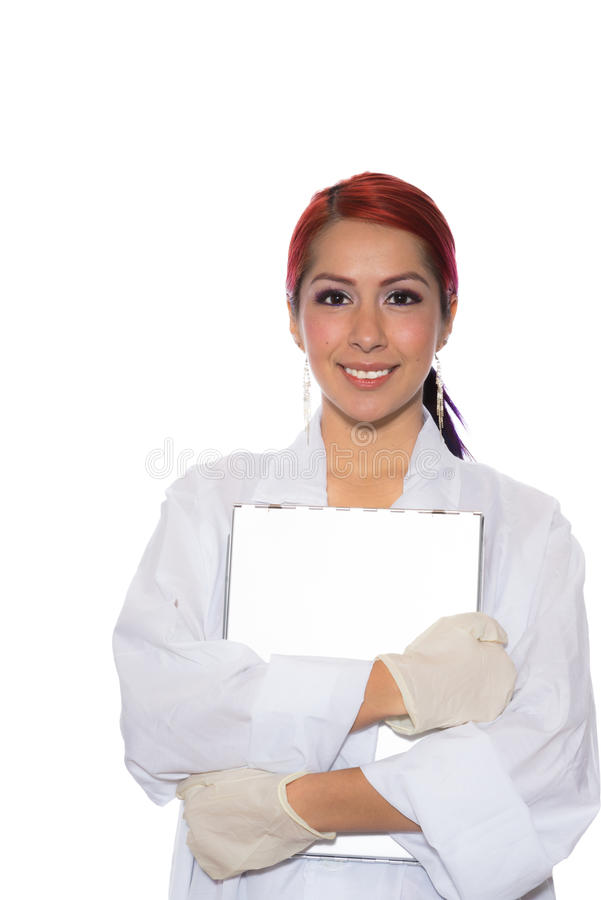 Hispanic Female Wearing Lab Coat While Holding Clipboard stock images