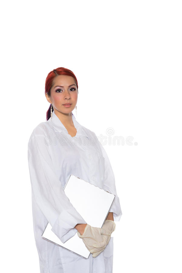 Hispanic Female Wearing Lab Coat While Holding Clipboard royalty free stock photography