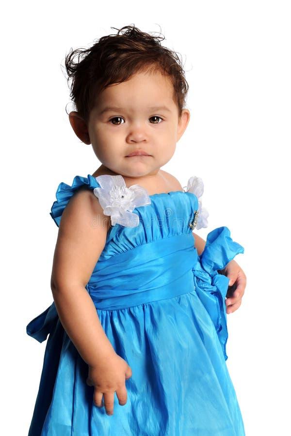 Hispanic Girl. Beautiful Hispanic girl in blue dress looking at camera isolated over white backgorund stock photo