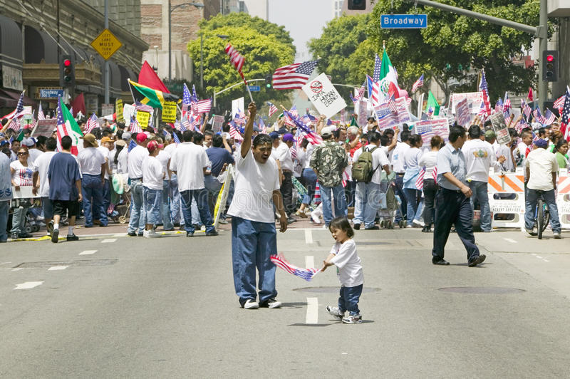 Hispanic girl and father with American flag. Watch hundreds of thousands of immigrants participating in march for Immigrants and Mexicans protesting against royalty free stock photography