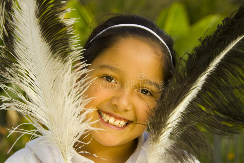 Download Hispanic girl and feathers stock photo. Image of elegant - 14859590