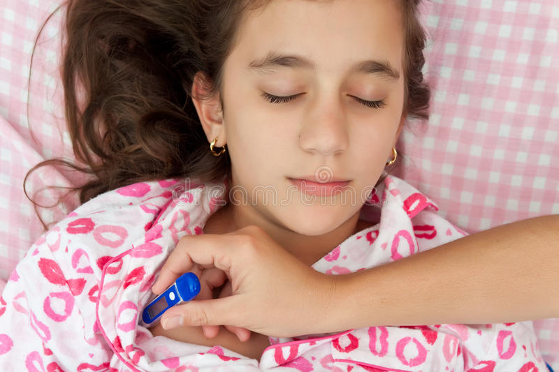 Download Hispanic Girl Sick With Fever Laying In Her Bed Stock Photo - Image of contagious, close: 23149344
