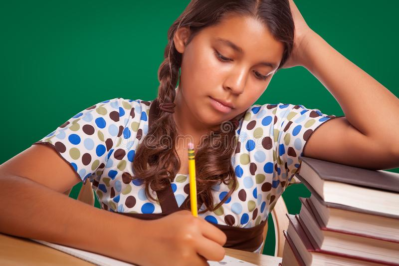 Hispanic Girl Student with Pencil and Books Studying royalty free stock photography