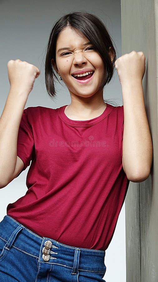 Hispanic Girl Teenager And Winning. A young female hispanic teen stock images