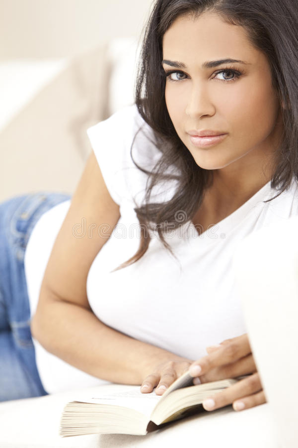 Download Hispanic Girl Or Woman Relaxing Reading A Book Stock Photo - Image: 19058116