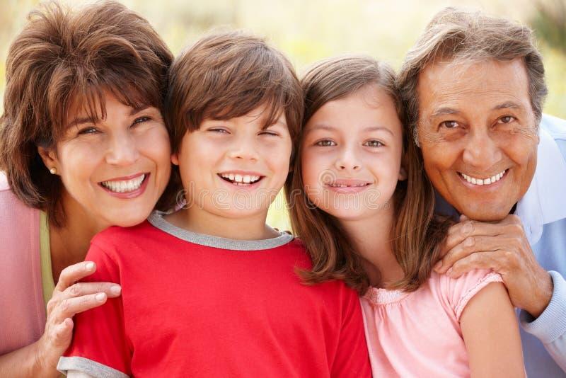 Hispanic grandparents and grandchildren outdoors stock image