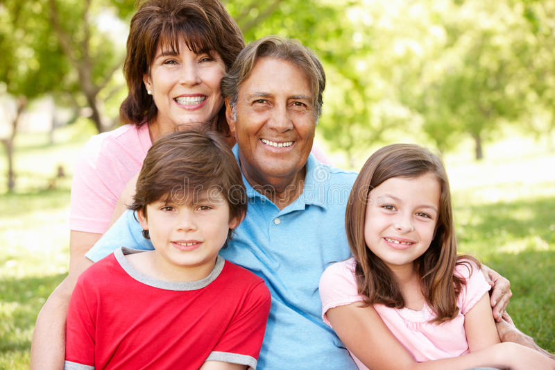 Hispanic grandparents and grandchildren outside stock images