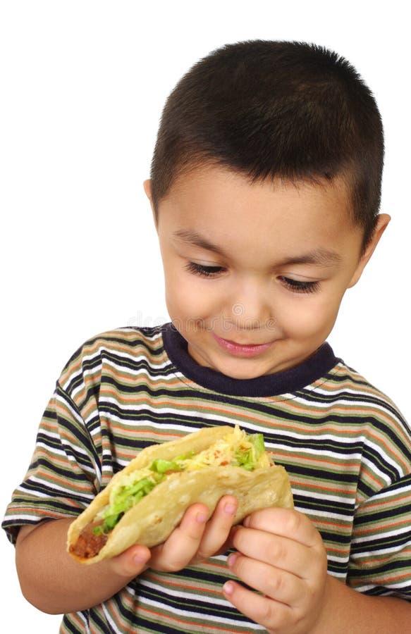 Hispanic kid with taco stock image