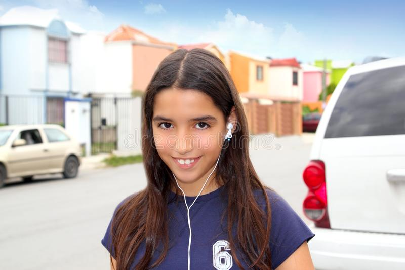 Hispanic latin teenager girl earphones music royalty free stock photo