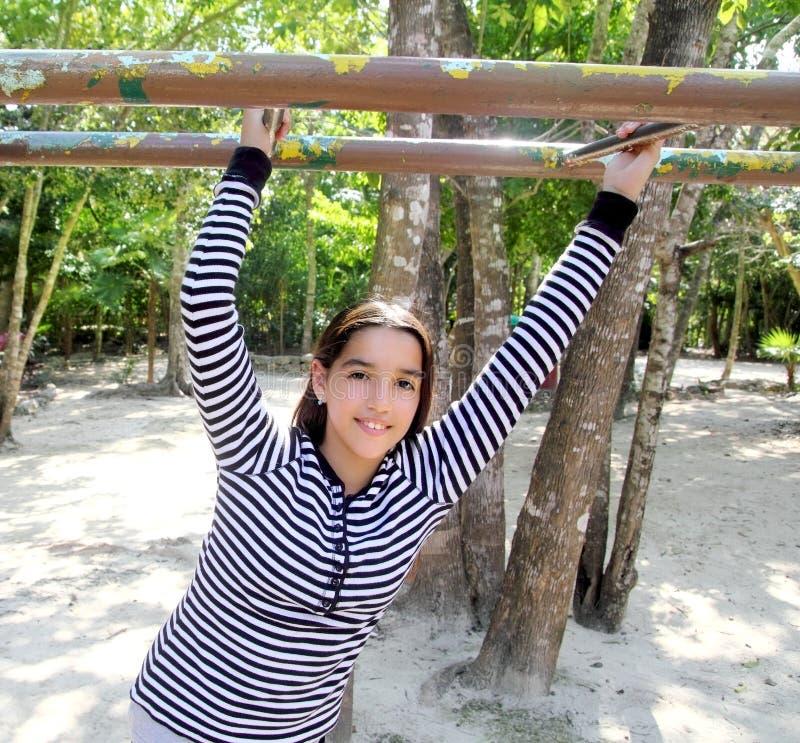 Hispanic latin teenager girl playing in park stock photography