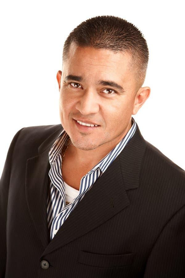 Hispanic Man. Smiling young Hispanic man in coat and striped shirt royalty free stock photography