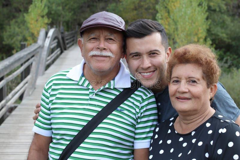 Hispanic man with his parents outdoors stock photos