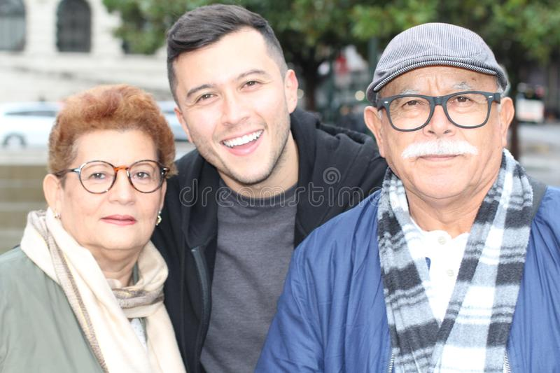 Hispanic man with his parents outdoors stock photos