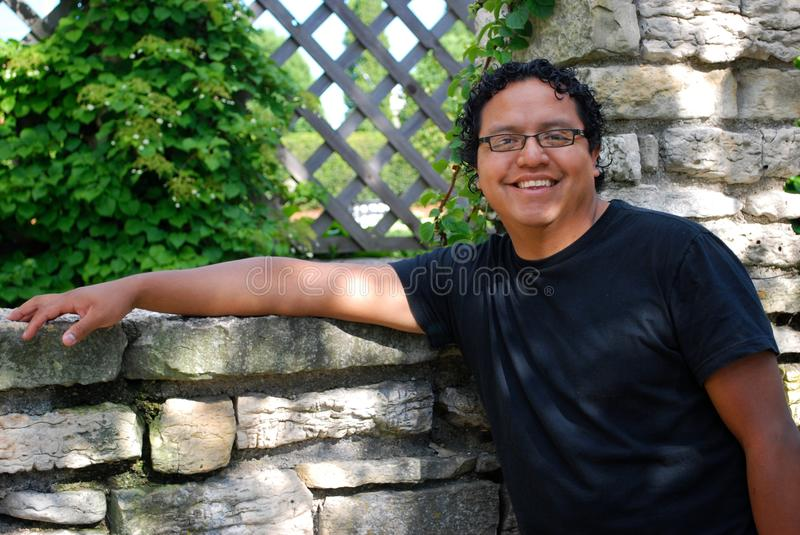 Hispanic man smiling outdoors stock images