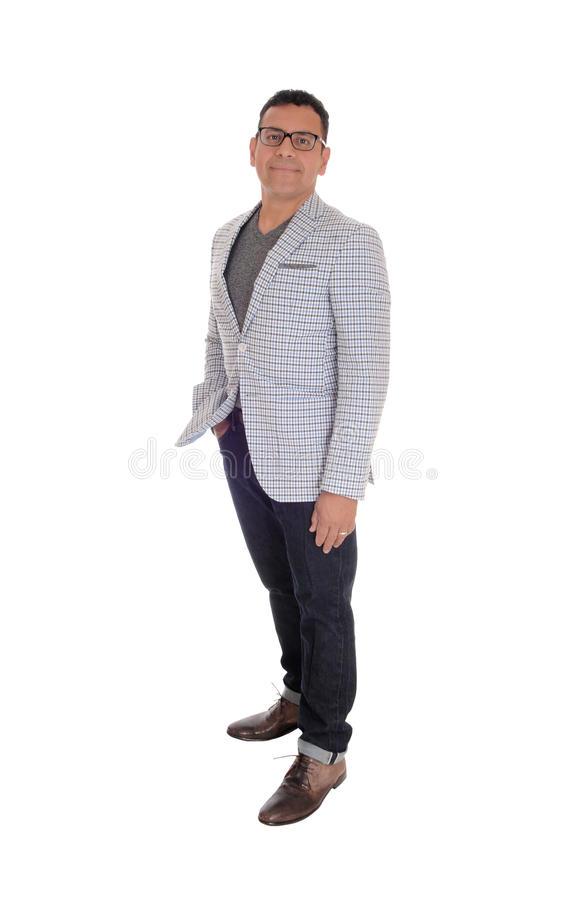 Hispanic man standing full lengths. A handsome middle age Hispanic man standing isolated for white background in a jacked and jeans royalty free stock photos