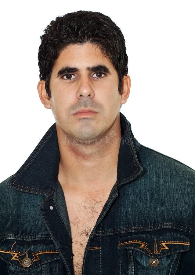 Hispanic man wearing an open denim jacket stock photos