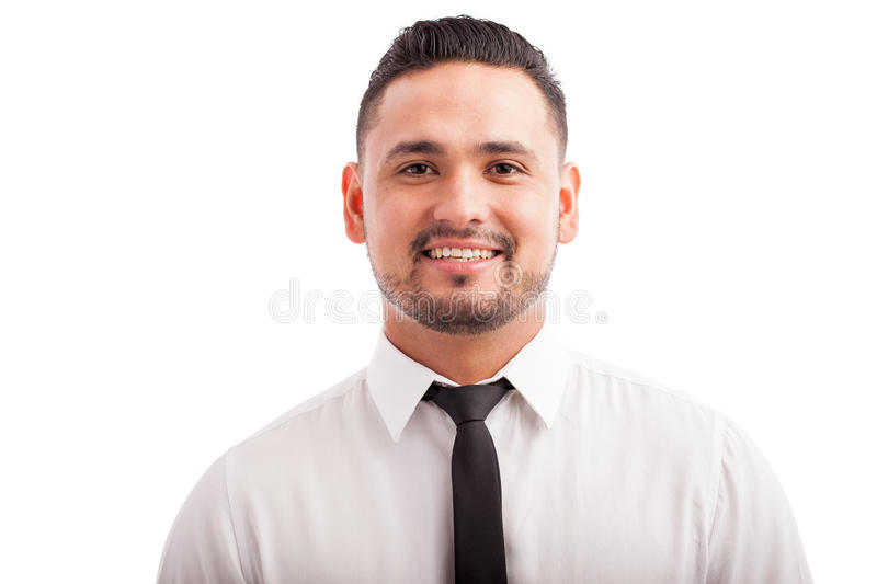 Hispanic man wearing a tie. Portrait of a good looking young Hispanic man wearing a tie and smiling against a white background royalty free stock photography