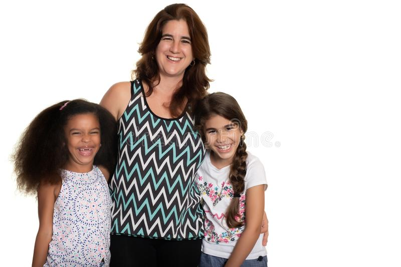 Hispanic mom with her two mixed race small girls stock photography