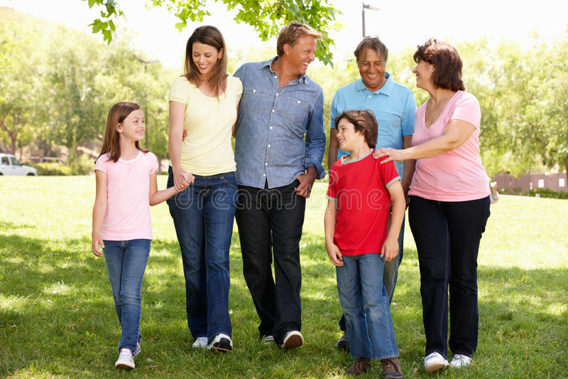 Hispanic Mulit generation family walking in park stock images